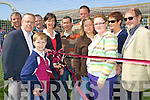 8778-8771.Cutting the ribbon on the new all weather pitch at Scoil Re?alt na Maidine NS .Listowel on Saturday was Seamus O'Sullivan, specially chosen from 2nd Year, and RTE Sport's Joe Stack along with teachers and well wishers.
