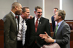 Nevada Sens., from left, Aaron Ford, Mark Hutchson, Scott Hammond and Greg Brower talk on the Senate floor at the Legislative Building in Carson City, Nev., on Tuesday, April 16, 2013. .Photo by Cathleen Allison