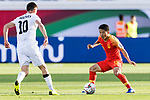Chi Zhongguo of China (R) is tackled by Mirlan Murzaev of Kyrgyz Republic (L) during the AFC Asian Cup UAE 2019 Group C match between China (CHN) and Kyrgyz Republic (KGZ) at Khalifa Bin Zayed Stadium on 07 January 2019 in Al Ain, United Arab Emirates. Photo by Marcio Rodrigo Machado / Power Sport Images