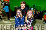 Saoirse Roome from Ballymac and Ariana Lyne from Killarney holding the lizard with Brendan Flemingat the at the Manor West Retail Park's Halloween Family Fun Day on Saturday.