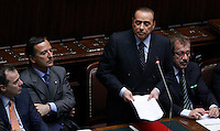 Il Presidente del Consiglio Silvio Berlusconi, secondo da destra, affiancato dal Ministro dell'Interno Roberto Maroni, destra, dal Ministro degli Esteri Franco Frattini, e dal Ministro per i Rapporti con il Parlamento Elio Vito, sinistra, pronuncia il suo discorso programmatico alla Camera dei Deputati a Roma, 13 maggio 2008, alla vigilia del voto di fiducia sul suo governo..Italian Premier Silvio Berlusconi, second from right, flanked by Interior Minister Roberto Maroni, right, Foreign Minister Franco Frattini and Relations with Parliament Minister Elio Vito, first from right, delivers his programme speech at the lower Chamber of Deputies, Rome, 13 may 2008, on the eve of a vote of confidence on his goverrnment..UPDATE IMAGES PRESS/Riccardo De Luca