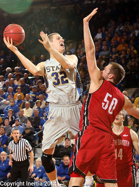 BROOKINGS, SD - MARCH 1:  Marcus Heemstra #32 from South Dakota State University shoots over Trevor Gruis #50 from the University of South Dakota in the first half or their game Saturday afternoon at Frost Arena in Brookings. (Photo by Dave Eggen/Inertia)