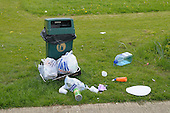 Rubbish dumped around an empty waste bin on council owned land.