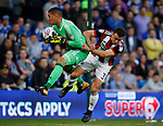 Neil Etheridge of Cardiff City clashes with Enda Stevens of Sheffield Utd  during the Championship match at the Cardiff City Stadium, Cardiff. Picture date: August 15th 2017. Picture credit should read: Simon Bellis/Sportimage