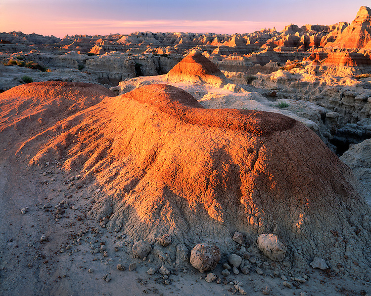 Sunrise light on eroded formations in the Badlands on the Door/Window Trail; Badlands National Park, SD