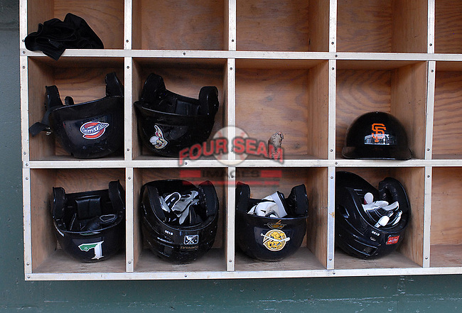 Helmets from various south teams are in the rack at the 2010 South Atlantic League All-Star Game on Tuesday, June 22, 2010, at Fluor Field at the West End in Greenville, S.C. Photo by: Tom Priddy/Four Seam Images
