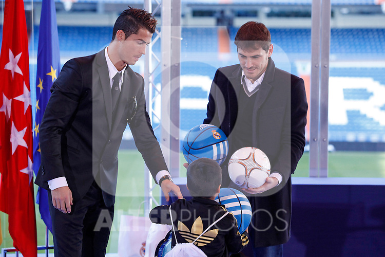 Real Madrid´s Cristiano Ronaldo and Iker Casillas attend the presentation of No kids without a present on Christmas campaign at Bernabeu stadium in Madrid, Spain. December 16, 2013. (ALTERPHOTOS/Victor Blanco)