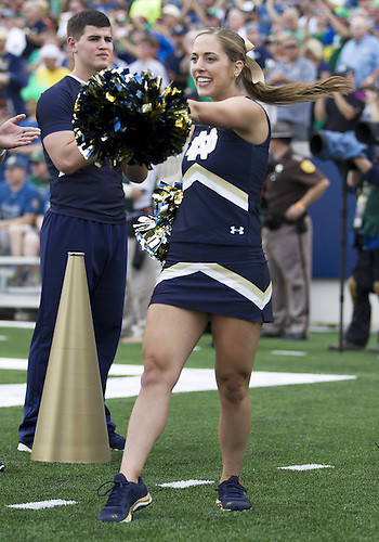 August 30, 2014:  Notre Dame cheerleader performs during NCAA Football game action between the Notre Dame Fighting Irish and the Rice Owls at Notre Dame Stadium in South Bend, Indiana.  Notre Dame defeated Rice 48-17.