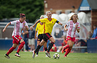 Anneka Nuttall of Watford Ladies heads forward past  Amy Josland (left) & Rosy Wodhams of Stevenage Ladies during the pre season friendly match between Stevenage Ladies FC and Watford Ladies at The County Ground, Letchworth Garden City, England on 16 July 2017. Photo by Andy Rowland / PRiME Media Images.