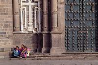 Peru, Cusco.  Three Quechua Women Sitting by Church Door.
