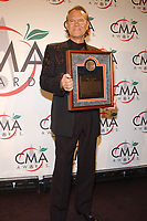 GLEN CAMPBELL<br /> 39th Annual CMA Awards held at Madison Square Garden. New York.<br /> USA, United States.<br /> 15th November 2005<br /> Ref: George Shepherd<br /> full length holding plaque award black suit smiling<br /> www.capitalpictures.com<br /> sales@capitalpictures.com<br /> &copy; Capital Pictures