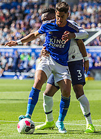 Ayoze Perez and Danny Rose battle for the ball during the Premier League match between Leicester City and Tottenham Hotspur at the King Power Stadium, Leicester, England on 21 September 2019. Photo by James  Gill / PRiME Media Images.