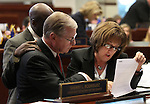 Nevada Senate Democrats, Kelvin Atkinson, David Parks and Debbie Smith work on the Senate floor at the Legislative Building in Carson City, Nev., on Monday, March 11, 2013..Photo by Cathleen Allison