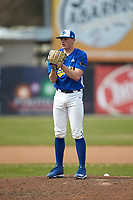 Mars Hill Lions relief pitcher Zach Grice (26) looks to his catcher for the sign against the Queens Royals at Intimidators Stadium on March 30, 2019 in Kannapolis, North Carolina. The Royals defeated the Bulldogs 11-6 in game one of a double-header. (Brian Westerholt/Four Seam Images)