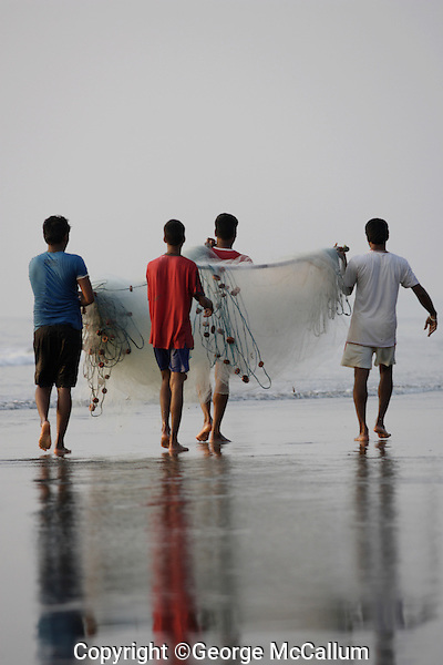 Beach fishermen carring Gill net , Goa, Arabian sea, India