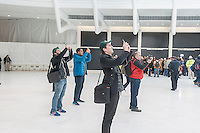 Visitors photograph the partially finished World Trade Center Transportation Hub, known as the Oculus, at its opening on Thursday, March 3, 2016. The over-budget, years late, $4 billion state-of-the-art transportation hub was designed by renowned architect Santiago Calatrava. When finished the hub will connect subway lines and PATH trains. (© Richard B. Levine)