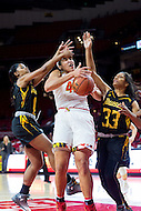 College Park, MD - DEC 6, 2016: Maryland Terrapins center Brionna Jones (42) is fouled hard going up strong to the basket by Towson Tigers guard Raine Bankston (10) and Towson Tigers center Daijha Thomas (33) during game between Towson and Maryland at XFINITY Center in College Park, MD. The Terps defeated the Tigers 97-63. (Photo by Phil Peters/Media Images International)