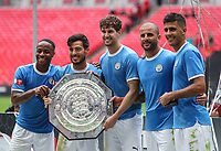 Raheem Sterling, David Silva, John Stones, Kyle Walker and Rodrigo of Manchester City pose with the FA Community Shield after the match between Liverpool and Manchester City at Wembley Stadium on August 4th 2019 in London, England. (Photo by John Rainford/phcimages.com)<br /> Foto PHC/Insidefoto <br /> ITALY ONLY