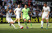 Samir Nasri of Manchester City (C) against Leon Britton (L) and Jack Cork of Swansea City during the Swansea City FC v Manchester City Premier League game at the Liberty Stadium, Swansea, Wales, UK, Sunday 15 May 2016