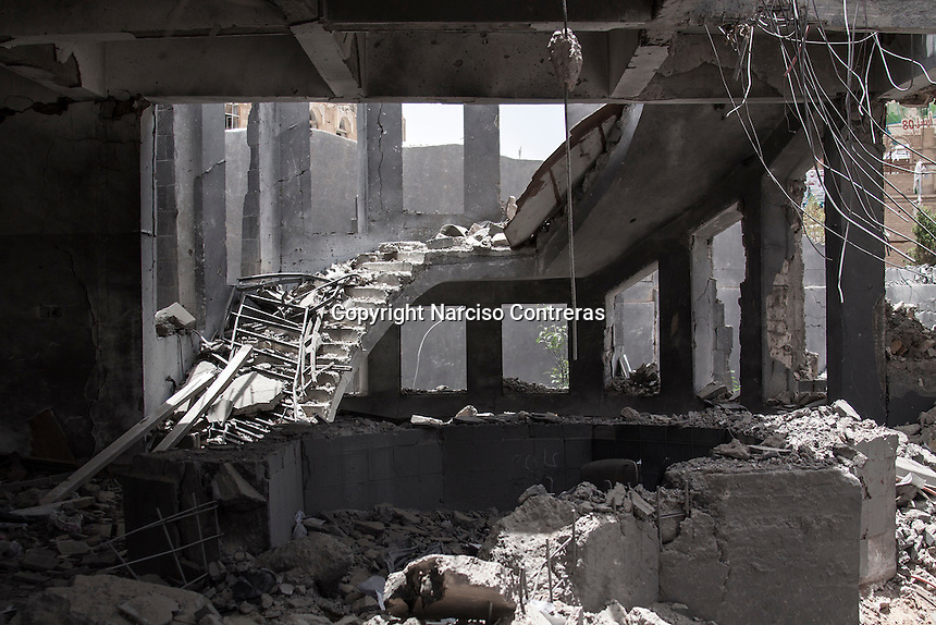 Wednesday 15 July, 2015: A destroyed governmental building is seen in the downtown of Sa'dah, a city subdued to heavy bombarments carried out by the Saudi-led coalition air force in the northern province of Sa'dah, the stronghold of the Houthi's movement in Yemen. (Photo/Narciso Contreras)