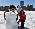 (Boston, Ma 030913) Pep Codina, of Boston, helps his daughter Emma, 3, build a snowman, Saturday, March 9, on the Boston Common. (Jim Michaud /Photo) For Sunday