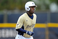 4 March 2012:  FIU outfielder Jabari Henry (14) runs to first base as the FIU Golden Panthers defeated the Brown University Bears, 8-3, at University Park Stadium in Miami, Florida.