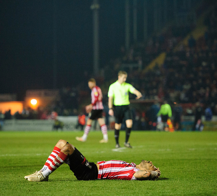 Lincoln City's Bruno Andrade reacts after missing a chance late on<br /> <br /> Photographer Chris Vaughan/CameraSport<br /> <br /> The EFL Sky Bet League Two - Lincoln City v Exeter City - Tuesday 26th February 2019 - Sincil Bank - Lincoln<br /> <br /> World Copyright © 2019 CameraSport. All rights reserved. 43 Linden Ave. Countesthorpe. Leicester. England. LE8 5PG - Tel: +44 (0) 116 277 4147 - admin@camerasport.com - www.camerasport.com