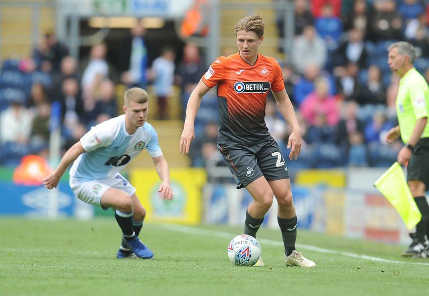 Swansea City's George Byers under pressure from Blackburn Rovers' Jacob Davenport<br /> <br /> Photographer Kevin Barnes/CameraSport<br /> <br /> The EFL Sky Bet Championship - Blackburn Rovers v Swansea City - Sunday 5th May 2019 - Ewood Park - Blackburn<br /> <br /> World Copyright © 2019 CameraSport. All rights reserved. 43 Linden Ave. Countesthorpe. Leicester. England. LE8 5PG - Tel: +44 (0) 116 277 4147 - admin@camerasport.com - www.camerasport.com