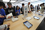 April 28, 2011, Tokyo, Japan - Applemanias get their hands on iPad2s at Apple Store in Tokyo Ginza shopping district as the tablet computers go on sale in Japan at long last on Thursday, April 28, 2011. iPad2 was originally set to go on sale on March 25 but was postponed as the country grapples with the earthquake and tsunami devastation. (Photo by Natsuki Sakai/AFLO) [3615] -mis-