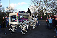 Dulwich fans applaud as the horse and carriage carrying the coffin of Mishi leaves the Stadium en route to the crematorium during the funeral of Dulwich Hamlet FC supporter Mishi Morath at Champion Hill Stadium on 15th January 2020