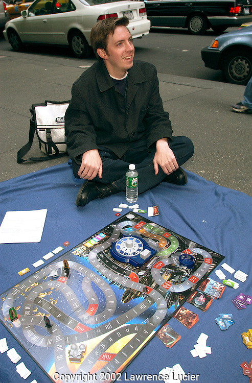 Star Wars fan Jamie Erwine plays the board game Star Wars Life on the opening day of the line for the Star Wars premiere April 27, 2002 in New York City. Line participants are using sponsorships to raise money for the Starlight Foundation, a children's health charity..