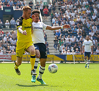 Preston North End's Callum Robinson battles with Burton Albion's Tom Naylor<br /> <br /> Photographer Alex Dodd/CameraSport<br /> <br /> The EFL Sky Bet Championship - Preston North End v Burton Albion - Sunday 6th May 2018 - Deepdale Stadium - Preston<br /> <br /> World Copyright &copy; 2018 CameraSport. All rights reserved. 43 Linden Ave. Countesthorpe. Leicester. England. LE8 5PG - Tel: +44 (0) 116 277 4147 - admin@camerasport.com - www.camerasport.com