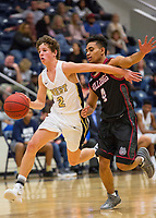 Springdale Bulldogs vs Bentonville West Woverines Basketball - Dillon Bailey (2) of Bentonville West brings the ball up the court as Joe<br />