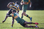 Nathan De Thierry tackles Sepu Taufa during the Counties Manukau Premier Club Rugby game between Pukekohe and Bombay, played at Colin Lawrie Fields, Pukekohe, on Saturday June 28 2014. Bombay won the game 24 - 20 after leading 12 - 11 at halftime  Photo by Richard Spranger