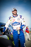 Jimmie Johnson (#48) stands by his car.