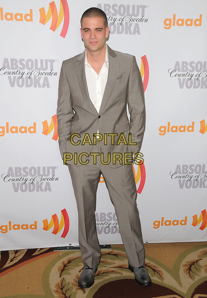 MARK SALLING .at the 21st Annual GLAAD Media Awards held at The Hyatt Regency Century Plaza in Century City, California  USA, April 17th 2010.       .full length suit hands in pockets beige grey gray white shirt .CAP/RKE/DVS.©DVS/RockinExposures/Capital Pictures.