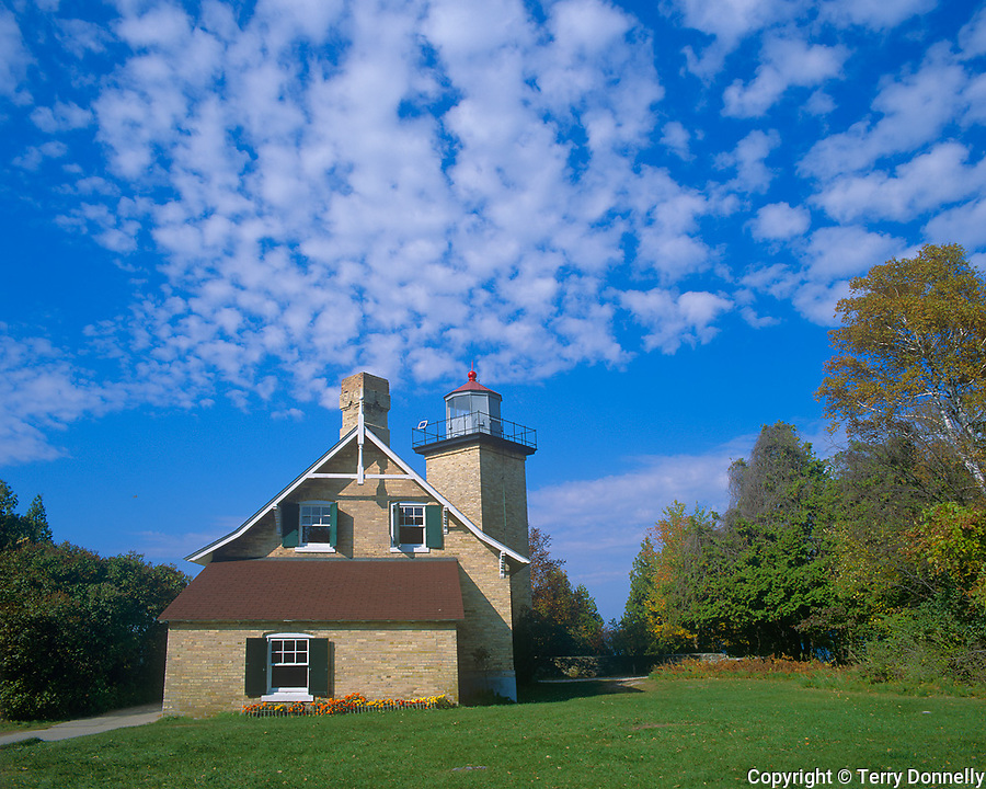 Door County, WI:  Eagle Bluff Lighthouse under scattered clouds, Peninsula State Park