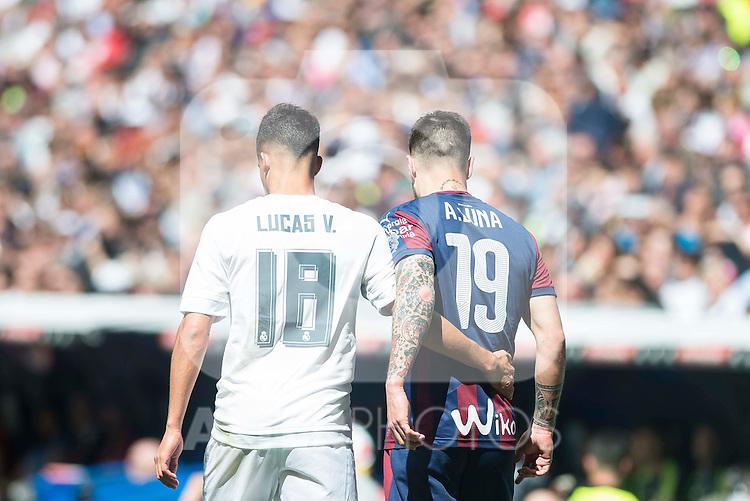 Real Madrid's Lucas Vazquez and Sociedad Deportiva Eibar's Antonio Luna during La Liga match. April 09, 2016. (ALTERPHOTOS/Borja B.Hojas)