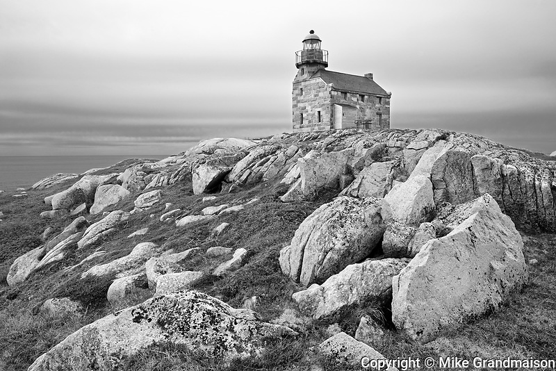 Restored granite lighthouse on the Atlantic Ocean<br />