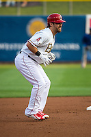 Collin Cowgill (12) of the Salt Lake Bees takes his lead at second base during the game against the Iowa Cubs in Pacific Coast League action at Smith's Ballpark on August 20, 2015 in Salt Lake City, Utah. The Cubs defeated the Bees 13-2.  (Stephen Smith/Four Seam Images)