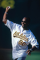 OAKLAND, CA - Jerry Rice throws out the first pitch before a game between the San Francisco Giants and Oakland Athletics at the Oakland Coliseum in Oakland, California on June 9, 2001. Photo by Brad Mangin