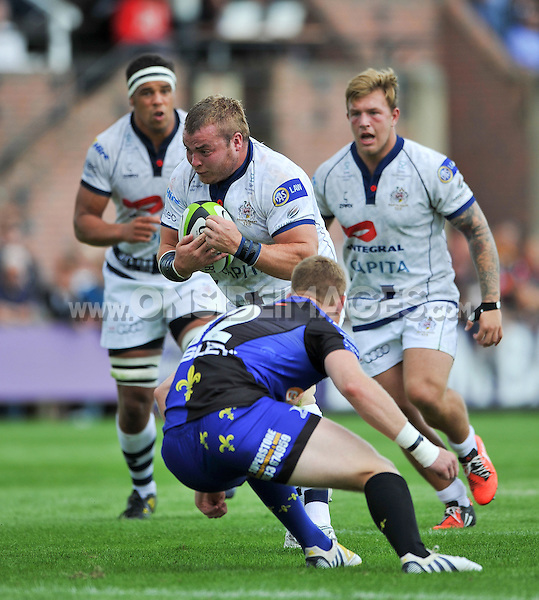 James Hall takes on the Dragons defence. Pre-season friendly match, between Bristol Rugby and Newport Gwent Dragons on August 17, 2014 at the Cribbs Causeway Ground in Bristol, England. Photo by: Patrick Khachfe / JMP