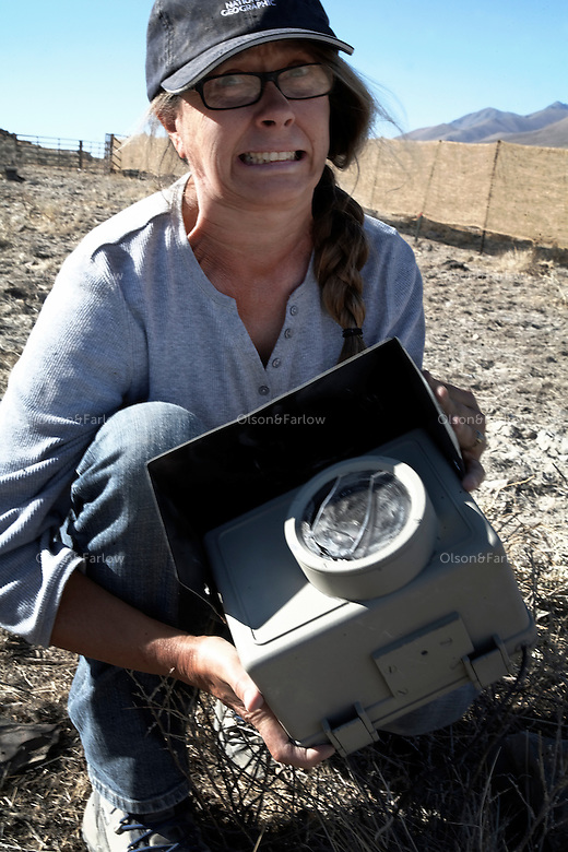 Photographer Melissa Farlow on assignment for National Geographic reacts to cracked plexiglass that protected her cameras while a herd of horses ran over it in Wyoming.