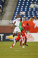 Guadeloupe forward Richard Socrier (21) heads the ball during the CONCACAF soccer match between Panama and Guadeloupe at Ford Field Detroit, Michigan.