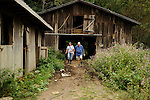 Jim and Charlene walk back to their house from one of their barns after feeding horses. Charlene is often several steps in front of Jim.
