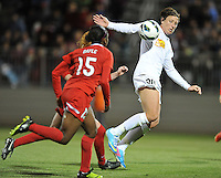 Abby Wambach (20) of The Western New York Flash tries to control the ball against Robyn Gayle (15) of the Washington Spirit. The Washington Spirit tied The Western New York 1-1 in the home opener of The National Women's Soccer League, at Maryland SoccerPlex, Saturday April 20, 2013.