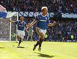 Steven Naismith scores his second and Rangers' fourth goal of the match and celebrates with David Healy