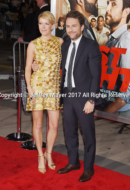 HOLLYWOOD, CA - FEBRUARY 13: Actor/Executive Producer Charlie Day (R) and wife/actress Mary Elizabeth Ellis attend the premiere of Warner Bros. Pictures' 'Fist Fight' at the Regency Village Theatre on February 13, 2017 in Westwood, California.