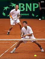 19-9-09, Netherlands,  Maastricht, Tennis, Daviscup Netherlands-France, Dubbles Thiemo de Bakker en Igor Sijsling(voorgrond)