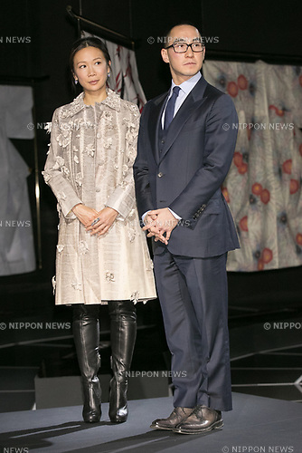Lawrence Ho (R) chairman and CEO of Melco Resorts and Entertainment Ltd. with his wife, attend the opening ceremony for the KIMONO ROBOTO exhibition at Omotesando Hills on November 30, 2017, Tokyo, Japan. The exhibition features 13 kimonos created by experts using traditional methods and a humanoid robot dressed in traditional kimono performing in the middle of the hall. The exhibition runs til December 10. (Photo by Rodrigo Reyes Marin/AFLO)
